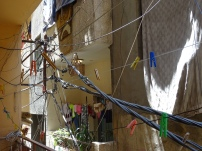 Making it work: Electricity cables and clothes lines over one of the alleyways in Baddawi refugee camp (Lebanon). (c) Fiddian-Qasmiyeh.