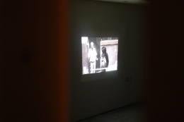 A projection of one of Samar Maqusi's first videos in Burj al-Barajneh camp, viewed through the spatial intervention. (c) E. Fiddian-Qasmiyeh