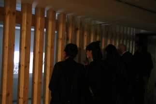 Visitors watching one of Samar Maqusi's videos (through/as) part of the spatial installation. (c) E. Fiddian-Qasmiyeh