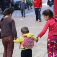 baddawi-3-children-in-street-holding-hands-2